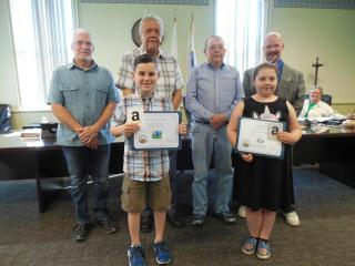 Community Solar art contest winners with Commissioners